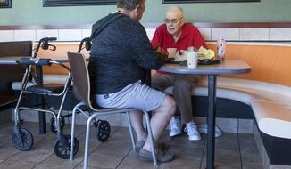 Douglas Talbot, left, and Lou, pictured here at McDonald's in Millcreek on Friday, May 25, 2018, have met for breakfast with friends every day for years.  (James Wooldridge/The Deseret News via AP)