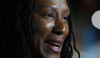 Former University of Tennessee standout Chamique Holdsclaw speaks during an interview at the Women's Basketball Hall of Fame, Friday, June 8, 2018, in Knoxville, Tenn. (AP Photo/Wade Payne)