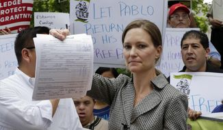 Legal Aid Society lawyer Jennifer WIlliams, who represents Ecuadorean restaurant worker Pablo Villavicencio, shows the Application for Stay of Deportation or Removal she filed at the offices of the Immigration and Customs Enforcement, in New York, Friday, June 8, 2018. Villavicencio, who was making a delivery to an Army garrison in Brooklyn, N.Y., wound up being detained June 1 after a routine background check at the gate revealed there was a warrant for his arrest for immigration law violations, officials said.  (AP Photo/Richard Drew)