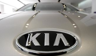 FILE - In this Jan. 28, 2011 file photo, KIA Motors logo is seen on a K7 sedan at a showroom in Seoul, South Korea.  Kia is recalling over a half-million vehicles in the U.S. because the air bags may not work in a crash. The recall apparently is related to federal investigation into air bag failures in Kia and partner Hyundai vehicles that were linked to four deaths. Vehicles covered by the recall include 2010 through 2013 Forte compact cars and 2011 through 2013 Optima midsize cars. Also covered are Optima Hybrid and Sedona minivans from 2011 and 2012.(AP Photo/Ahn Young-joon, File)