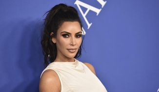 In this June 4, 2018, file photo, Kim Kardashian West arrives at the CFDA Fashion Awards at the Brooklyn Museum in New York. The reality star successfully appealed to President Donald Trump to release Alice Marie Johnson from prison. Johnson, who spent more than two decades in federal prison on 1996 drug convictions and was not eligible for parole, had her sentence commuted this week. (Photo by Evan Agostini/Invision/AP, File)