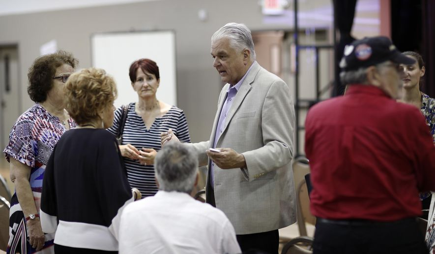 FILE - In this May 8, 2018, file photo, Clark County Commission member Steve Sisolak meets with people during a forum for Nevada gubernatorial candidates organized by Nevada faith groups. The fiercest primary election battle in Nevada this year is a race between two Democrats vying to become the swing state's first Democratic governor in almost two decades. The fight between Sisolak and Christina Giunchigliani has seen them spar over their response to the October mass shooting in Las Vegas while pledging to resist President Donald Trump and the National Rifle Association.(AP Photo/John Locher, File)