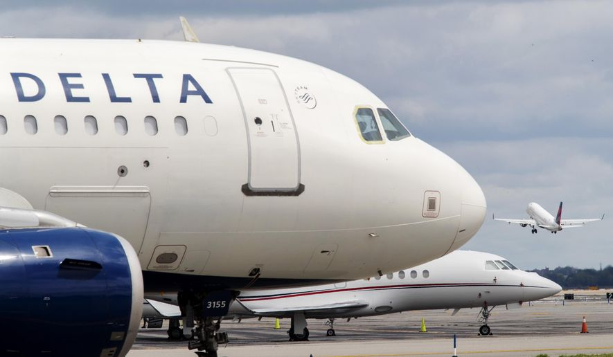 FILE - In this Aug. 8, 2017, file photo, a Delta Air Lines jet waits on the tarmac at LaGuardia Airport in New York. A false offer circulating on Facebook shows what appears to be a promotion from Delta claiming the company is giving away free tickets to celebrate its 93rd birthday. Delta says the promotion is a fake and the airline is not celebrating its 93rd birthday this year. (AP Photo/Mary Altaffer, File)