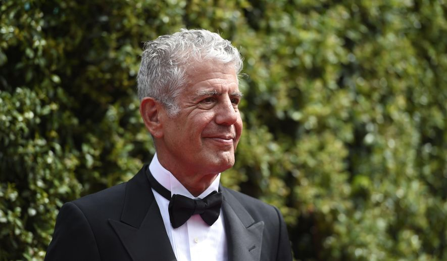 FILE - In this Saturday, Sept. 12, 2015 file photo, Anthony Bourdain arrives at the Creative Arts Emmy Awards in Los Angeles. On Friday, June 8, 2018, Bourdain was found dead in his hotel room in France, while working on his CNN series on culinary traditions around the world. (Photo by Chris Pizzello/Invision/AP)