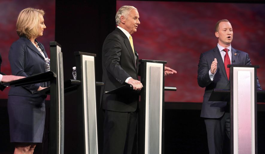 Republicans Catherine Templeton, left, Gov. Henry McMaster, center, and John Warren participate in a gubernatorial primary debate at the University of South Carolina, Tuesday June 5, 2018 in Columbia, S.C.. (Grace Beahm Alford/The Post And Courier via AP)