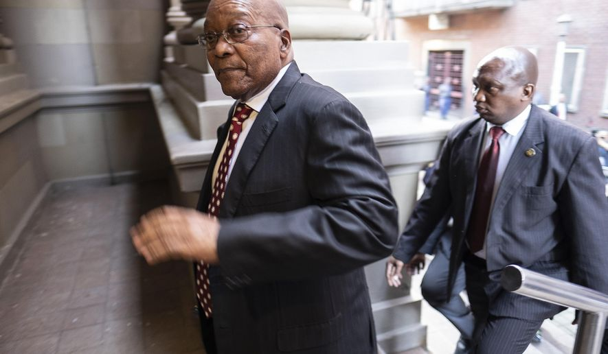 Former South African President Jacob Zuma arrives at the High Court in Durban, South Africa, Friday, June 8, 2018. Zuma is in court to face 16 charges of fraud, corruption and racketeering. (Marco Longari/Pool via AP)