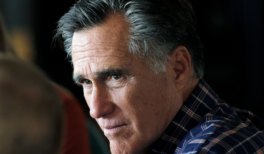 FILE - In this March 3, 2018, file photo, Mitt Romney speaks with a group during a breakfast campaign stop in Green River, Utah. Romney's annual gathering of top Republicans, wealthy political donors and powerful business leaders kicks off Thursday, June 7 in the Utah ski town of Park City with U.S. House Speaker Paul Ryan among the expected attendees at a three-day event that comes just weeks ahead of Romney's primary election in his bid to win the U.S. Senate seat in Utah. (AP Photo/Rick Bowmer, File)