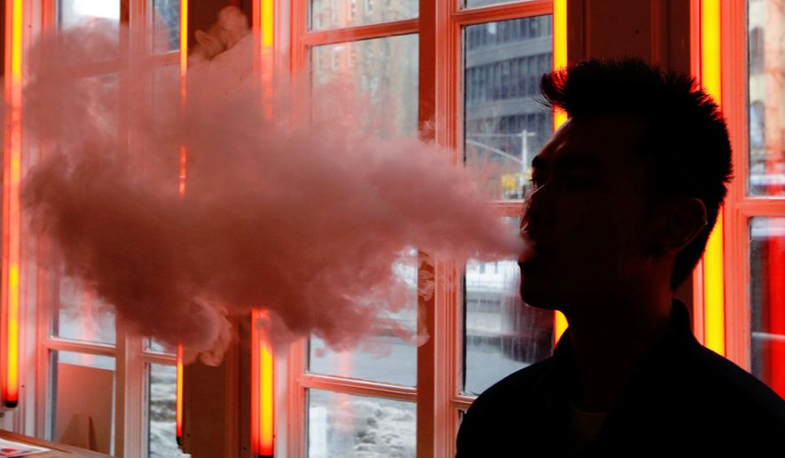 Vape enthusiasts may consider giving up their habit if the Chinese-produced devices are hit by Trump administration tariffs. (Associated Press/File)