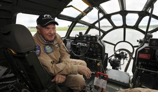 """Pilot Tom Travis is shown in the cockpit of """"Fifi,"""" one of few flyable B-29 Superfortress vintage World War II-era bombers in the world, at the John Murtha Johnstown-Cambria County Airport in Johnstown, Pa., Monday, June 4, 2018. Several vintage WWII-era military aircraft from the Commemorative Air Force (CAF) arrived with """"Fifi"""" as part of an upcoming AirPower History Tour, including a P-51C Mustang, T-6 Texan and C-45 Expeditor. They will be on public display from Wednesday through Sunday. (John Rucosky/The Tribune-Democrat via AP)"""