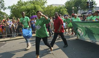 Washington Mayor Muriel Bowser marches in the Capital Pride Parade in Washington, Saturday, June 9, 2018. The yearly event is hosted by and in support of the LGBTQ+ community and moves through the Dupont Circle and Logan Circle neighborhoods of Washington. (AP Photo/Carolyn Kaster) ** FILE **