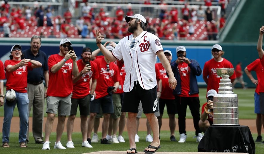 Washington Capitals' Alex Ovechkin, from Russia, reacts after throwing out the first of two ceremonial first pitches before a baseball game between the Washington Nationals and the San Francisco Giants at Nationals Park, Saturday, June 9, 2018, in Washington. (AP Photo/Alex Brandon)