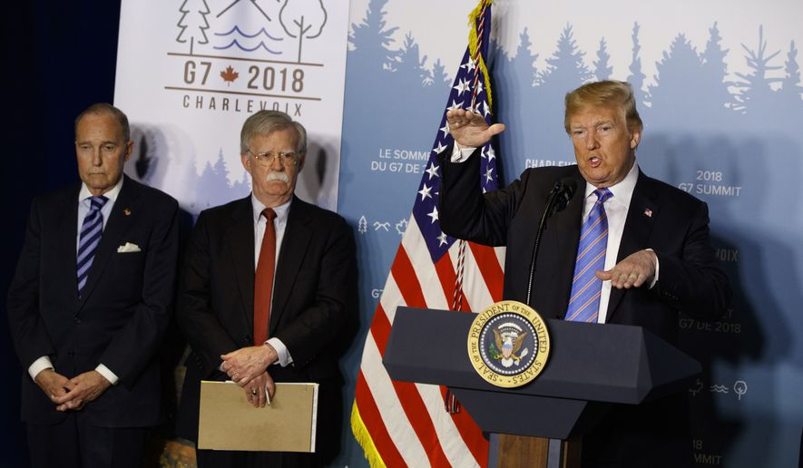 White House chief economic adviser Larry Kudlow, left, and National Security Adviser John Bolton look on as President Donald Trump speaks during a news conference at the G-7 summit, Saturday, June 9, 2018, in La Malbaie, Quebec, Canada.  (AP Photo/Evan Vucci) (AP Photo/Evan Vucci)