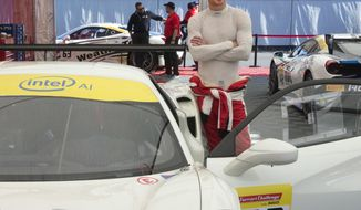Actor Michael Fassbender gets ready for the Ferarri Challenge practice at the Formula One Canadian Grand Prix auto race in Montreal, Friday, June 8, 2018. (Ryan Remiorz/The Canadian Press via AP)