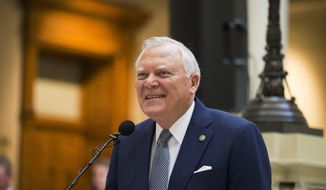 FILE- This May 2, 2,2018 file photo shows Georgia Gov. Nathan Deal speaking at the Georgia State Capitol building in Atlanta. Georgia has asked vendors to stop collecting local sales tax on jet fuel, just months after the lieutenant governor effectively killed a broader sales tax exemption on it to punish Delta Air Lines for eliminating discount fares for members of the National Rifle Association. (Alyssa Pointer/Atlanta Journal-Constitution via AP, File)