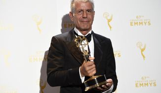 "FILE - In this Saturday, Sept. 12, 2015 file photo, Anthony Bourdain, winner of the award for outstanding informational series or special for ""Anthony Bourdain Parts Unknown,"" poses with his trophy in the press room at the Creative Arts Emmy Awards in Los Angeles. On Friday, June 8, 2018, Bourdain was found dead in his hotel room in France, while working on his CNN series on culinary traditions around the world. (Photo by Chris Pizzello/Invision/AP)"