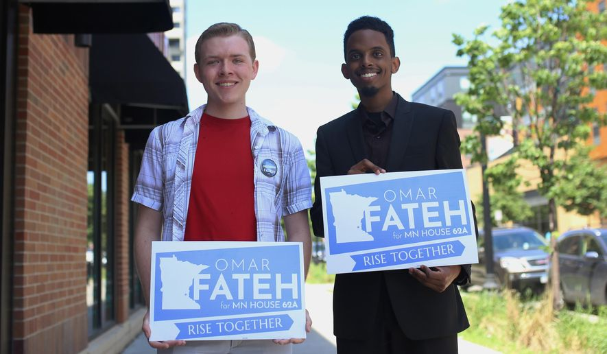 In this June 1, 2018, photo, University student Austin Berger, left, poses for a portrait with Omar Fateh, who is running for the Minnesota House of Representatives in Dinkytown, Minn. Berger and other student staffers created a unionization campaign based on Rep. Erin Murphy's campaign for governor. (Easton Green/The Minnesota Daily via AP)