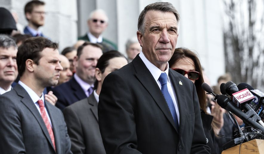 Vermont Republican Gov. Phil Scott pauses while speaking before signing the first significant gun restrictions bills in the state's history during a ceremony on the steps of the Statehouse in Montpelier, VT, Wednesday, April 11, 2018. (AP Photo/Cheryl Senter)