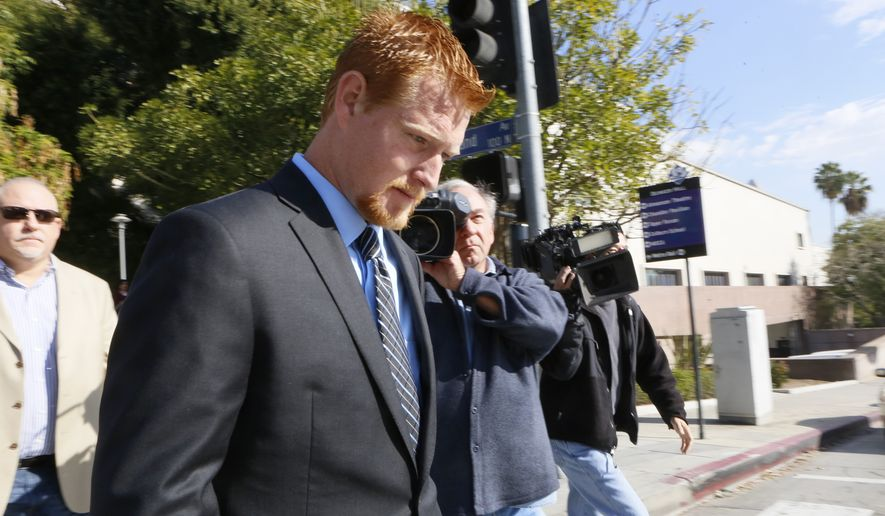 Redmond O'Neal leaves court for a lunch break on Thursday, Dec. 12, 2013, in Los Angeles. (Associated Press)