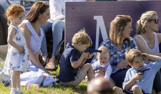 Britain's Kate, the Duchess of Cambridge, left, sits with Prince George and other unidentified spectators as they watch Prince William take part in the Maserati Royal Charity Polo Trophy at the Beaufort Polo Club, in Tetbury, England, Sunday June 10, 2018. (Steve Parsons/PA via AP)