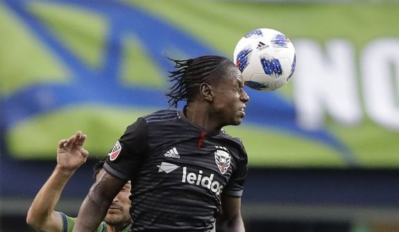 D.C. United forward Darren Mattocks heads the ball against the Seattle Sounders during an MLS soccer match, Saturday, June 9, 2018, in Seattle. The Sounders won 2-1. (AP Photo/Ted S. Warren) ** FILE **
