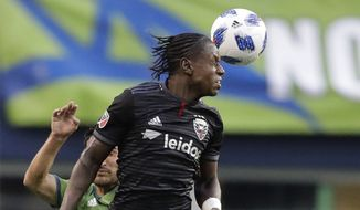 D.C. United forward Darren Mattocks heads the ball against the Seattle Sounders during an MLS soccer match, Saturday, June 9, 2018, in Seattle. The Sounders won 2-1. (AP Photo/Ted S. Warren)