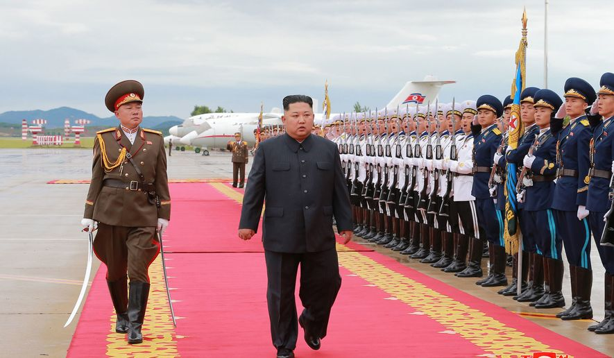 "In this Sunday, June 10, 2018, photo provided by the North Korean government, North Korean leader Kim Jong Un, center, prepares to leave for Singapore, at Pyongyang international airport in Pyongyang, North Korea. Independent journalists were not given access to cover the event depicted in this image distributed by the North Korean government. The content of this image is as provided and cannot be independently verified. Korean language watermark on image as provided by source reads: ""KCNA"" which is the abbreviation for Korean Central News Agency. (Korean Central News Agency/Korea News Service via AP)"
