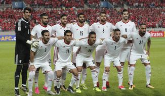 In this photo taken on Thursday, Aug. 31, 2017, Iran's team players, back row from left, Alireza Beiranvand, Ramin Rezaeian, Alireza Jahanbakhsh, Mohammad Ansari, Morteza Pouraliganji, Saeid Ezatolahi and front row from left, Ehsan Hajsafi, Vahid Amiri, Reza Ghoochannejhad, Milad Mohammadi, Ashkan Dejagah pose for the team photo before the 2018 Russia World Cup Group A qualifying soccer match against South Korea at Seoul World Cup Stadium in Seoul, South Korea. (AP Photo/Lee Jin-man) ** FILE **