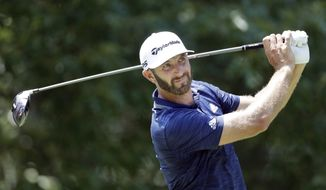 Dustin Johnson watches his drive on the seventh hole during the final round of the St. Jude Classic golf tournament Sunday, June 10, 2018, in Memphis, Tenn. (AP Photo/Mark Humphrey)