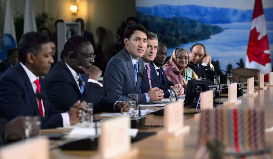 Canada's Prime Minister Justin Trudeau participates in the G-7 Working Session with Outreach Countries and International Organizations at the G-7 Summit in La Malbaie, Quebec on Saturday, June 9, 2018. (Sean Kilpatrick/The Canadian Press via AP)