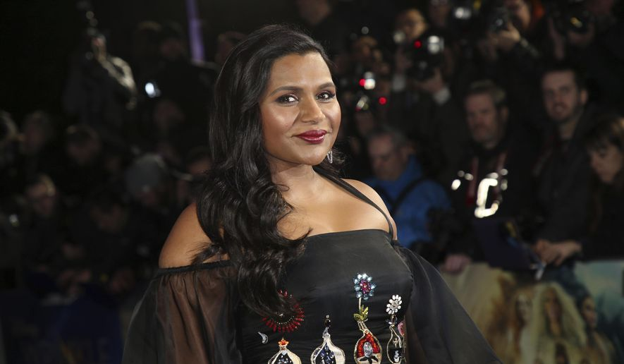 FILE - In this March 13, 2018, file photo, actress Mindy Kaling poses for photographers upon arrival at the premiere of the film 'A Wrinkle In Time' in London. Kaling gave the commencement address to Dartmouth College graduates on Sunday, June 10. (Photo by Joel C Ryan/Invision/AP, File)