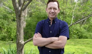 """This May 3, 2018 photo shows Silas House, the author of """"Southernmost"""",   in the backyard of his home in Berea, Ky.,    (Tom Eblen/Lexington Herald-Leader via AP)"""