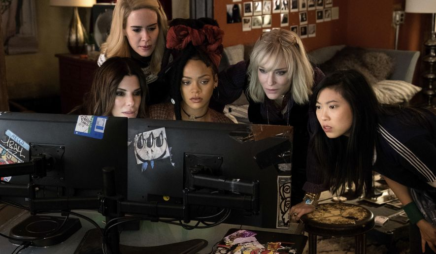 """This image released by Warner Bros. shows, from foreground left, Sandra Bullock Sarah Paulson, Rihanna, Cate Blanchett and Awkwafina in a scene from """"Ocean's 8."""" (Barry Wetcher/Warner Bros. via AP)"""