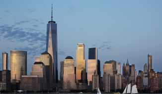 In this June 7, 2018 photo, One World Trade Center towers over its neighbors, including 3 World Trade Center, center, an 80-story office building in New York. (AP Photo/Mark Lennihan)