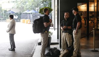 Members of the U.S. Secret Service Counter Sniper Team wait outside the lobby of the Shangri-La Hotel in Singapore, Sunday, June 10, 2018, ahead of the summit between U.S. President Donald Trump and North Korean leader Kim Jong-un. (AP Photo/Yong Teck Lim) ** FILE **