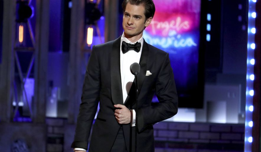 """Andrew Garfield accepts the award for best leading actor in a play for """"Angels in America"""" at the 72nd annual Tony Awards at Radio City Music Hall on Sunday, June 10, 2018, in New York. (Photo by Michael Zorn/Invision/AP)"""