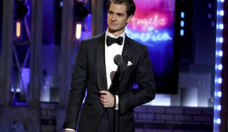 "Andrew Garfield accepts the award for best leading actor in a play for ""Angels in America"" at the 72nd annual Tony Awards at Radio City Music Hall on Sunday, June 10, 2018, in New York. (Photo by Michael Zorn/Invision/AP)"