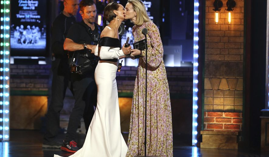 "Laurie Metcalf, left, kisses presenter Carey Mulligan as she accepts the award for best featured actress in a play for ""Edward Albee's Three Tall Women"" at the 72nd annual Tony Awards at Radio City Music Hall on Sunday, June 10, 2018, in New York. (Photo by Michael Zorn/Invision/AP)"