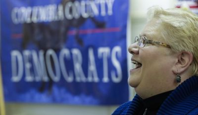 Wisconsin assembly candidate Ann Groves Lloyd speaks at an event at the offices of Columbia County Democratic Party, Saturday, April 14, 2018, in Portage, Wis. (AP Photo/Morry Gash)