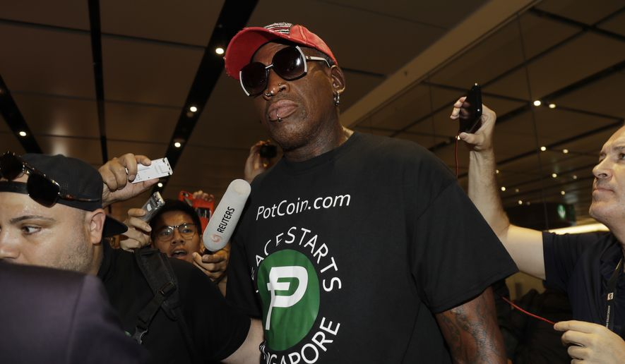 Former NBA basketball player Dennis Rodman arrives at Singapore's Changi Airport on Tuesday, June 12, 2018. (AP Photo/Wong Maye-E)