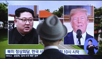 "A man watches a TV screen showing file footage of U.S. President Donald Trump, right, and North Korean leader Kim Jong Un during a news program at the Seoul Railway Station in Seoul, South Korea, Monday, June 11, 2018.  Final preparations are underway in Singapore for Tuesday's historic summit between President Trump and North Korean leader Kim, including a plan for the leaders to kick things off by meeting with only their translators present, a U.S. official said.  The signs read: "" Summit between the United States and North Korea."" (AP Photo/Ahn Young-joon)"