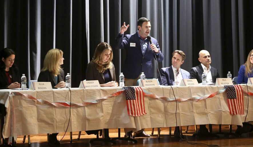 Candidates running in the Democratic primary for the Virginia 10th Congressional District seat currently held by Rep. Barbara Comstock, R-Va., participate in a candidates forum Saturday, Feb. 17, 2018 at James Wood Middle School in Winchester, Va. From left are Julia Biggins, Lindsey Davis Stover, Alison Friedman, Daniel Helmer, Paul Pelletier, Deep Sran and Jennifer Wexton. The primary is June 12, 2018. (Jeff Taylor/The Winchester Star via AP)