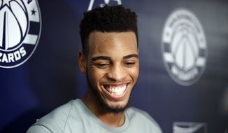 NBA draft prospect Troy Brown Jr., right, from Oregon, smiles during a media availability after an NBA pre-draft basketball workout Monday, June 11, 2018, in Washington. (AP Photo/Alex Brandon) ** FILE **