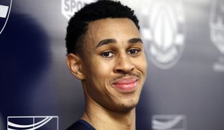 NBA draft prospect Zhaire Smith, right, from Texas Tech, smiles during a media availability after an NBA pre-draft basketball workout Monday, June 11, 2018, in Washington. (AP Photo/Alex Brandon)