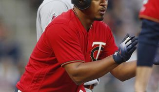Minnesota Twins' Eduardo Escobar celebrates his stand-up triple off Los Angeles Angels pitcher Garrett Richards in the third inning of a baseball game Friday, June 8, 2018, in Minneapolis. (AP Photo/Jim Mone)