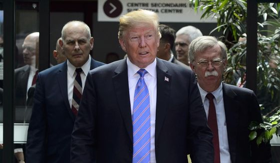 U.S. President Donald Trump leaves the G7 Leaders Summit in La Malbaie, Que., on Saturday, June 9, 2018., with White House Chief of Staff John Kelly, left, and National Security Adviser John Bolton. (Sean Kilpatrick/The Canadian Press via AP)