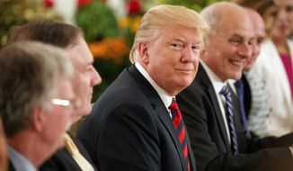 President Donald Trump listens during a meeting with Singapore Prime Minister Lee Hsien Loong ahead of a summit with North Korean leader Kim Jong-un, Monday, June 11, 2018, in Singapore. (AP Photo/Evan Vucci)