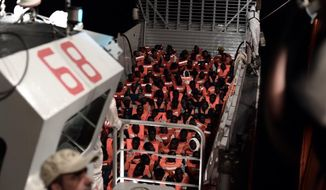 """CORRECTS NAME OF BOAT   This undated photo released by by French NGO """"SOS Mediterranee"""" on Monday June 11, 2018 and posted on it's Twitter account, shows migrants aboard SOS Mediterranee's Aquarius ship and MSF (Doctors Without Borders) NGOs, in the Mediterranean Sea. Italy and Malta dug in for a second day and refused to let the rescue ship Aquarius with 629 people aboard dock in their ports, leaving the migrants at sea as a diplomatic standoff escalated under Italy's new anti-immigrant government. (Kenny Karpov/SOS Mediterranee via AP)"""