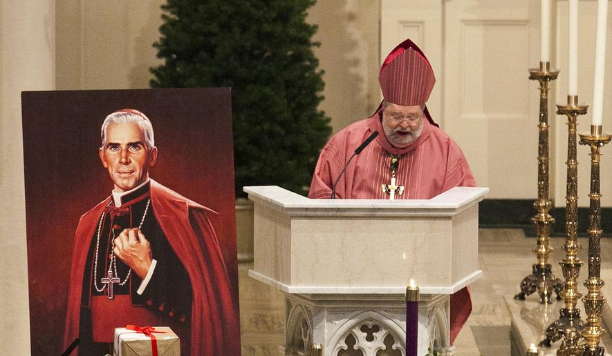 FILE - In this Dec. 11, 2011 file photo, Peoria Bishop Daniel Jenky, center, gives a sermon next to a painting of Archbishop Fulton John Sheen and the sealed box of documentation for the alleged miracle performed by Sheen, during a Mass at Cathedral of St. Mary of the Immaculate Conception in Peoria, Ill. The remains of Sheen, who died in 1979 and are at St. Patrick's Cathedral in Manhattan, can be moved to Illinois from New York, nearly 40 years after his death, a New York judge said Friday, June 8, 2018. Joan Sheen Cunningham, 90, believes moving her uncle's remains to Peoria, will improve his cause for sainthood. (Eve Edelheit/Journal Star via AP, File)