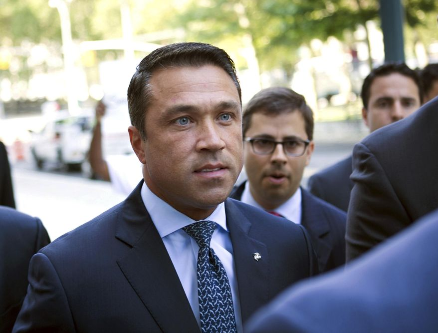 FILE - In this July 17, 2015 file photo, former U.S. Rep. Michael Grimm arrives ahead of his sentencing for aiding in filing a false tax return, at federal court in the Brooklyn borough of New York. On Monday, June 11, 2018, the first debate between the two men running in a no-holds-barred Republican Congressional primary for 11th Congressional District, which covers conservative Staten Island as well as a slice of Brooklyn, was heated and at times hostile. But incumbent Congressman Dan Donovan and Grimm both spoke of their support for President Donald Trump, and getting his agenda accomplished. (AP Photo/Kevin Hagen)