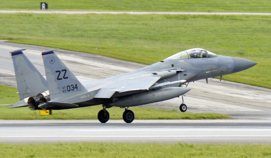 This May, 2017 photo shows a U.S. Air Force F-15 fighter jet at Kadena Air Base on the southern island of Okinawa in Japan. The U.S. military says an Air Force F-15C fighter jet has crashed in waters south of Okinawa in southern Japan Monday, June 11, 2018. (Kyodo News via AP)